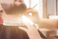 Shave the beard in the barbershop Stock Images