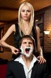 Shave. Beautiful youth woman, get shave guy hazardous razor stock photography