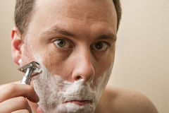 Shave the face Stock Image