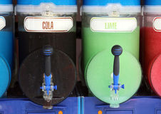 Shave ice machine with many cola and lime flavors Royalty Free Stock Photo