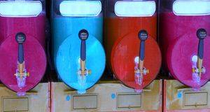 Shave ice machine with many colored flavors and iced Stock Photos