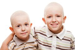 Shaved heads children smiling. Family happiness - two little smiling brothers with bald shaved heads Royalty Free Stock Photos