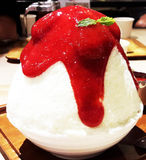 Shaved ice with strawberry sauce Royalty Free Stock Image