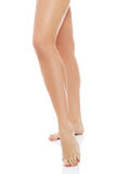 Shaved and smooth woman's long legs. Royalty Free Stock Images