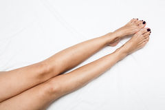 Shaved and smooth woman's long legs.  on white. Stock Image