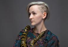 Shaved woman and yellow anaconda Stock Photography