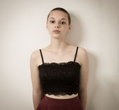 Shaven Bald Teenage Girl With Black Top and Bare Shoulders Royalty Free Stock Photos
