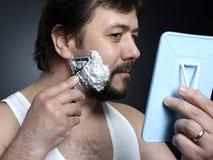 Shaving. Portrait  of a man shaving Stock Image