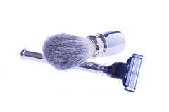 Shaving accessories. Facilities for shaving. razor and shaving brush made ​​of metal. on a white background Stock Photos