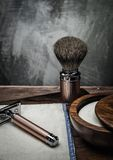 Shaving accessories. On a luxury wooden background stock image