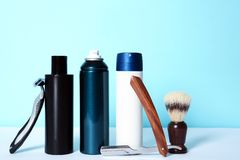 Shaving accessories for men on table. Against color background royalty free stock photography