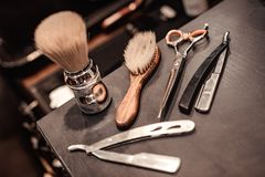 Tools of barber shop. Shaving accessories and tools of barber shop on wooden background stock photos