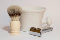 Shaving accessories. Traditional shaving equipment, brush, razor and mug Stock Photography