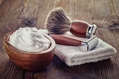 Shaving accessories. On wooden background stock photography