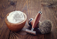 Shaving accessories. On wooden background stock photo