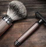 Shaving accessories on wooden background Royalty Free Stock Images