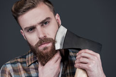 Shaving with axe. Stock Photography