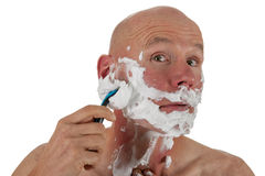 Shaving bald man Royalty Free Stock Image