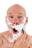 Shaving bald man Stock Image