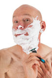 Shaving bald man Royalty Free Stock Photography