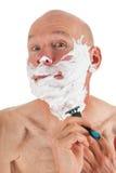 Shaving bald man Royalty Free Stock Photography