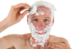 Shaving bald man Stock Photos