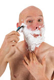 Shaving bald man Stock Images