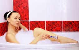 Shaving in the bath. Stock Image