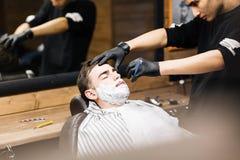 Shaving beard of guy Royalty Free Stock Photos