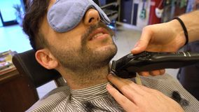 Shaving the beard in a old style barber shop stock footage