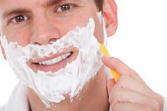 Shaving The Beard With A Razor Royalty Free Stock Photography
