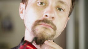 Shaving beards CU Stock Photos