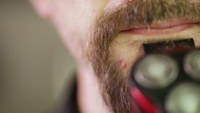 Shaving beards CU Royalty Free Stock Photos