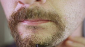 Shaving beards CU Royalty Free Stock Photography