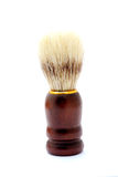 Shaving brush. A brand new shaving brush with badger hair for men with wooden grip. Image isolated on white studio background royalty free stock photos