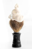 Shaving brush with foam on white background Royalty Free Stock Images