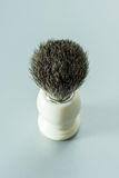 Shaving brush  on grey background. Royalty Free Stock Image