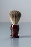 Shaving brush  on grey background. Royalty Free Stock Images