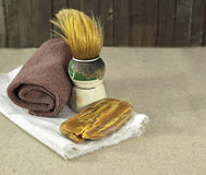 Shaving brush with natural soap and towel Royalty Free Stock Photos