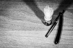 Shaving brush and razor blade. Retro, dark, black and white. Selective focus Stock Photography