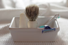 Shaving brush and razor in a soap dish Royalty Free Stock Images