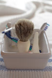Shaving brush and razor in a soap dish Stock Photography