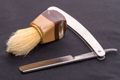 Shaving brush and straight razor Stock Image