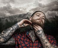 Shaving brutal tattooed male. stock photography