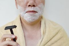 Shaving cream on man face with shaver on right hand prepare to shaved Royalty Free Stock Photos
