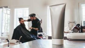 Shaving cream tube barbershop counter stock photo