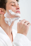 Shaving face Royalty Free Stock Image