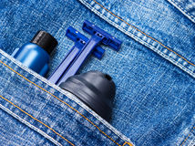 Shaving foam, disposable razors and aftershave lotion. Mens cosmetics. Shaving foam, disposable razors and aftershave lotion in jeans pocket. Basic skin care stock photos