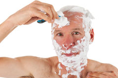 Shaving the head Royalty Free Stock Images
