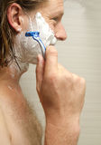Shaving His Face Stock Photography